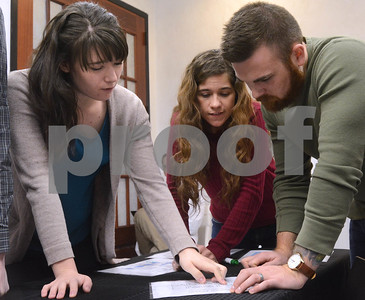 "Abigail Arnold, (left) from Elmhurst, Barbara Caine, from Hobart, IN, and Matt Strysik, from Lisle try to figure out a puzzle Jan. 6 at CluedIn Escape Rooms in Glen Ellyn. Participants must decipher puzzles, riddles and other games in order solve a mystery and ""escape"" from a room. Mark Busch - mbusch@shawmedia.com"