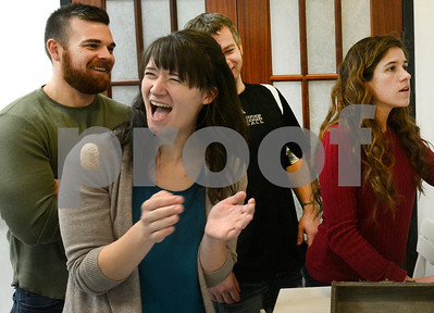 "Abigail Arnold (second from left) from Elmhurst and some of her teammates have a laugh as they continue to look for clues Jan. 6 at CluedIn Escape Rooms in Glen Ellyn. Participants must solve puzzles, riddles and other games in order solve a mystery and ""escape"" from a room. Mark Busch - mbusch@shawmedia.com"