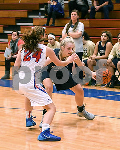 IC Catholic Prep's Claire Gibler tries to dribble around Glenbard South defender during their game Jan. 20 in Glen Ellyn. David Toney for Shaw Media