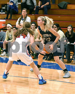 IC Catholic Prep's Claire Gibler looks for an open teammate during the game Jan. 20 against Glenbard South in Glen Ellyn. David Toney for Shaw Media