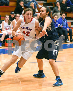 IC Catholic Prep's Domenica Flores defends Glenbard South's Maggie Bair during their game Jan. 20 in Glen Ellyn. David Toney for Shaw Media