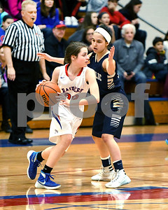 IC Catholic Prep's Demitra DelFiacco plays defense against Glenbard South's Raquel LaPonte during their game Jan. 20 in Glen Ellyn. David Toney for Shaw Media
