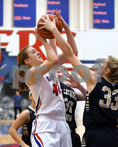 Glenbard South's Maggie Bair gets fouled during the game against IC Catholic Prep Jan. 20 in Glen Ellyn. David Toney for Shaw Media
