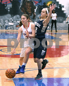 Glenbard South's Sarah Cohen dribbles the ball towards the basket during the game against IC Catholic Prep Jan. 20 in Glen Ellyn. David Toney for Shaw Media