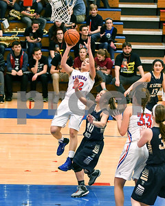 Glenbard South's Mady Carli scores in the second quarter of the game against IC Catholic Prep Jan. 20 in Glen Ellyn. David Toney for Shaw Media
