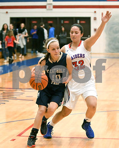 IC catholic Prep's Sophie Zanoni tries to drive past Glenbard South's Mady Carli during their game Jan. 20 in Glen Ellyn. David Toney for Shaw Media