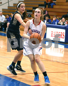 Glenbard South's Maggie Bair scores and is fouled by IC Catholic Prep's Tess Reardon during the game Jan. 20 in Glen Ellyn. David Toney for Shaw Media