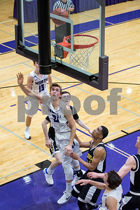 Downers Grove North's, Ryan Pustelnik, 21, shoots during the second period of the home game against Lyons Township on Friday, January 27th. Lorae Mundt for Shaw Media