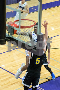 Downers Grove North's Eddie Boston takes a jump shot during the second period of the home game against Lyons Township on Friday, January 27th. Lorae Mundt for Shaw Media