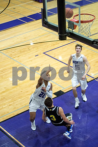 Downers Grove North's Sema'j Henderson shoots during the second period of the home game against Lyons Township on Friday, January 27th. Lorae Mundt for Shaw Media