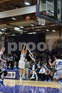 Downers Grove North's Anthony Castelvecchi takes a three point shot during the first period of the home game against Lyons Township on Friday, January 27th. Lorae Mundt for Shaw Media