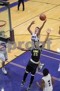 Downers Grove North's Anthony Castelvecchi beats out Lyons Township's Eli Bright for control of the rebound the second period of the home game on Friday, January 27th. Lorae Mundt for Shaw Media