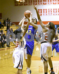 Lyons Township's Camille Branch goes up for a shot against St. Joseph during their game Jan. 7 in Westchester. David Toney for Shaw Media