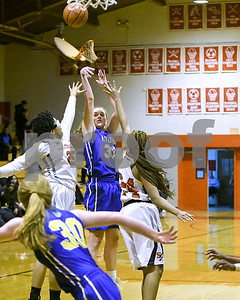 Lyons Township's Lily Courier takes a shot against St. Joseph during their game Jan. 7 in Westchester. David Toney for Shaw Media