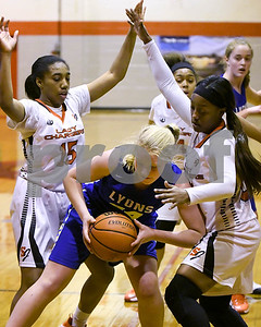 Lyons Township's Emma Fink is defended by  St. Joseph's Maia Marshall (right) and Brandi Thibeaux during their game Jan. 7 in Westchester. David Toney for Shaw Media