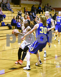 St. Joseph's Chelsea Cross gets fouled by Lyons Township's Claire Purcell during their game Jan. 7 in Westchester. David Toney for Shaw Media