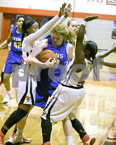 Lyons Township's Claire Purcell gets fouled while rebounding a ball by St. Joseph's Davane Gross during their game Jan. 7 in Westchester. David Toney for Shaw Media