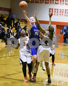 Lyons Township's Lily Courier goes up for a shot and gets fouled by  St. Joseph's Takyra Jackson during their game Jan. 7 in Westchester. David Toney for Shaw Media