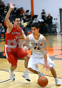 Wheaton Warrenville South's Parker Robinson drives past a Naperville Central defender during their game Jan. 7 in Wheaton. Mark Busch - mbusch@shawmedia.com