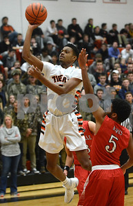 Wheaton Warrenville South's Dillon Durrett hangs in the air to score over a Naperville Central defender during their game Jan. 7 in Wheaton. Mark Busch - mbusch@shawmedia.com