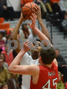 Wheaton Warrenville South's Dillon Durrett goes strong to the basket during their game against Naperville Central Jan. 7 in Wheaton. Mark Busch - mbusch@shawmedia.com