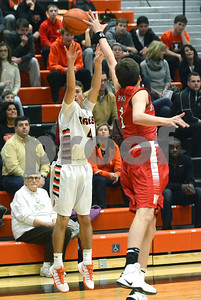 Wheaton Warrenville South's Jake Healy shoots a three over a Naperville Central defender during their game Jan. 7 in Wheaton. Mark Busch - mbusch@shawmedia.com