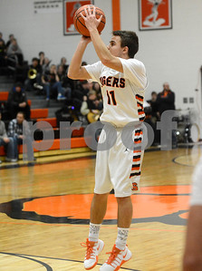 Wheaton Warrenville South's Drew Healy shoots a midrange jumper during their game against Naperville Central Jan. 7 in Wheaton. Mark Busch - mbusch@shawmedia.com