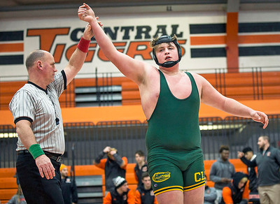 John Konstantaras - for Shaw Media Crystal Lake South sophomore Dom Collado has his arm raised after defeating Crystal Lake Central's Ramon Fuentes on Wednesday, January 3, 2018 in Crystal Lake, Illinois. Collado, a NCAA Division I football prospect, is wrestling for the first time at 285 on the JV team.