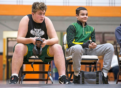 John Konstantaras - for Shaw Media Crystal Lake South sophomore Dom Collado (left) watches a match as he waits to wrestle against Crystal Lake Central on Wednesday, January 3, 2018 in Crystal Lake, Illinois. Collado is an NCAA Division I football prospect. Collado, a NCAA Division I football prospect, is wrestling for the first time at 285 on the JV team.