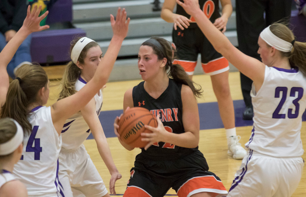 Sarah Nader - snader@shawmedia.com McHenry's Aannah Interrante (center) looks for a teammate to pass to during the third quarter at Friday's game against Hampshire Jan. 5, 2018. McHenry won, 53-48.