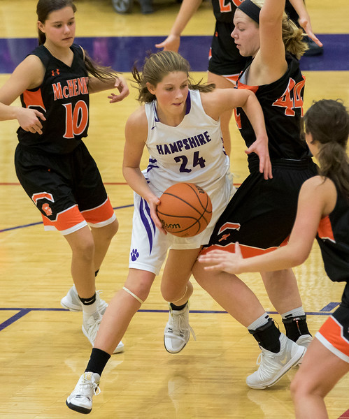Sarah Nader - snader@shawmedia.com Hampshire's Kelby Bannerman dribbles towards the basket during the fourth quarter at Friday's game in Hampshire Jan. 5, 2018. McHenry won, 53-48.
