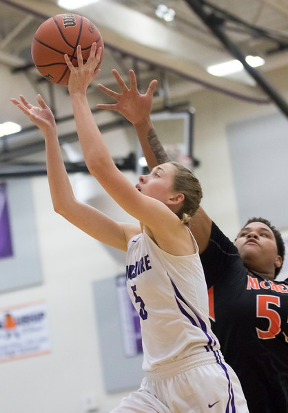 Sarah Nader - snader@shawmedia.com Hampshire's McKenzie Rasmussen (left) is guarded by MCHenry's Avalon Henderson while shooting a basket during the first quarter at Friday's game in Hampshire Jan. 5, 2018. McHenry won, 53-48.