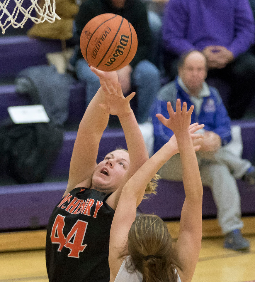 Sarah Nader - snader@shawmedia.com McHenry's Liz Alsot shoots a basket during the third quarter at Friday's game against Hampshire in Hampshire Jan. 5, 2018. McHenry won, 53-48.