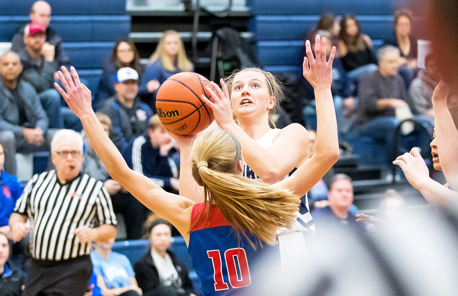 Whitney Rupp for Shaw Media Katie Sowa of Cary-Grove takes a shot over Katelyn Skibinski of Dundee-Crown Saturday, Jan. 20 at Cary-Grove High School.