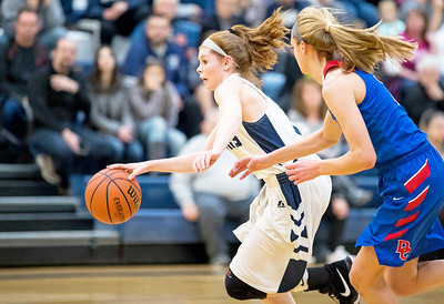 Whitney Rupp for Shaw Media Cary Grove's Bailey Steinkamp drives the ball down the court against Dundee-Crown Saturday, Jan. 20 at Cary-Grove High School.