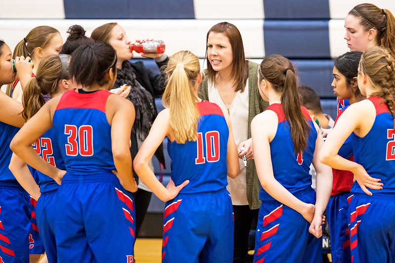 Whitney Rupp for Shaw Media Dundee-Crown girls basketball coach Sarah Miller addresses her team during a timeout at Cary-Grove High School Saturday, Jan. 20.