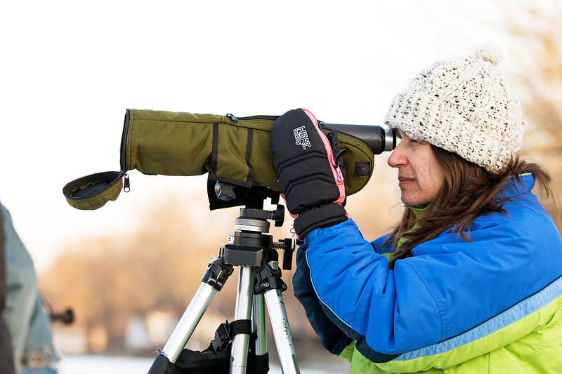 Whitney Rupp for Shaw Media Mary Corrado, Crystal Lake, looks for eagles at the Stratton Lock and Dam in McHenry Saturday, Jan. 20.