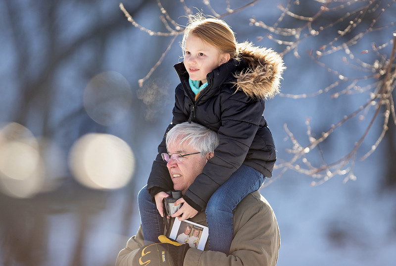 Whitney Rupp - for Shaw Media Charlotte Heaphy, 8, Huntley, looks for eagles with her grandfather, Eric Tannhauser of Lake in the Hills at the Algonquin Dam Saturday, Jan. 20.