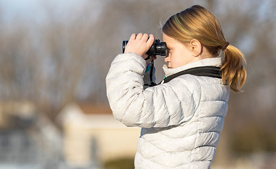 Whitney Rupp for Shaw Media Emily Porreca, 9, Spring Grove, uses binoculars to view birds at the Stratton Lock and Dam in McHenry Saturday, Jan. 20. Emily is a self-proclaimed raptor fan and was hoping to spot an eagle.