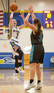 Kaitlyn Owen (2) from Johnsburg takes a shot over Amaya Saldana (32) from Woodstock North during the second quarter of their game at Johnsburg High School on Monday January 22, 2018 in Johnsburg, Illinois. John Konstantaras photo for Shaw Media
