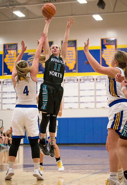 Hanna Seils (11) from Woodstock North puts up a shot over Megan Madsen (4) from Johnsburg during the first quarter of their game at Johnsburg High School on Monday January 22, 2018 in Johnsburg, Illinois. John Konstantaras photo for Shaw Media