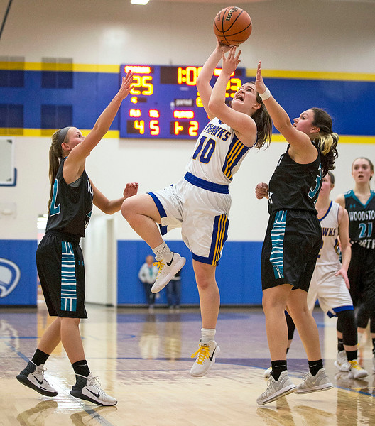 Sarah Metze (10) from Johnsburg drives to the basket between Taylor Prerost (left, 22) and Amaya Saldana (32) from Woodstock North during the second quarter of their game at Johnsburg High School on Monday January 22, 2018 in Johnsburg, Illinois. John Konstantaras photo for Shaw Media