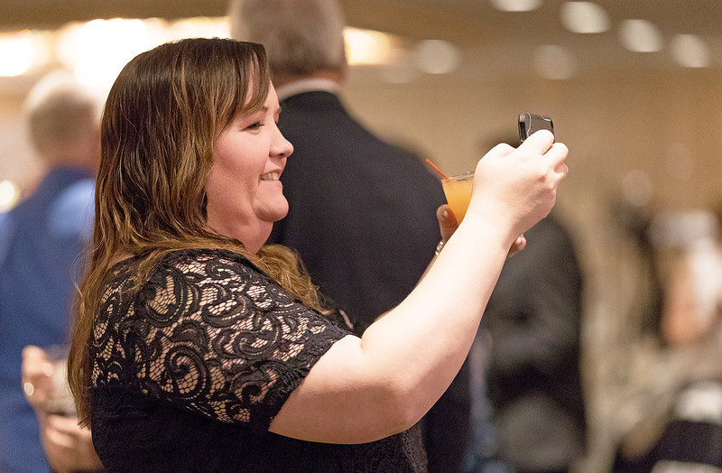 Whitney Rupp for Shaw Media Kelly Raske, McHenry, captures a moment during the McHenry Area Chamber of Commerce Dinner Dance Jan. 27.