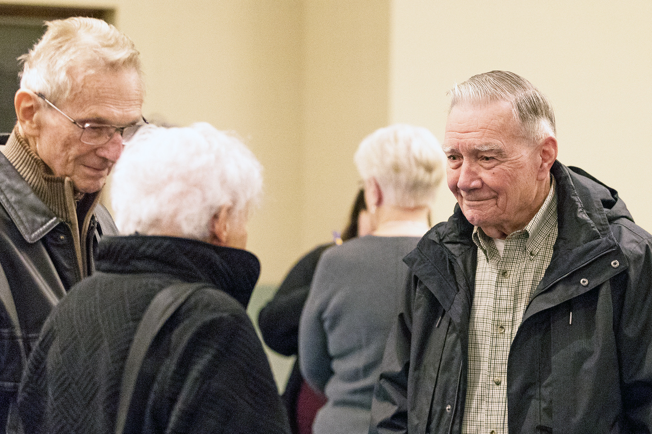 Whitney Rupp for Shaw Media Milt Mickow, left, and wife Joan Mickow, center, visit with Jim Weltzien, Crystal Lake at the 90th anniversary celebration of St. Thomas School in Crystal Lake Jan. 27.
