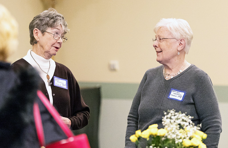 Whitney Rupp for Shaw Media Holly Peterson, left, and Mary Ann Weltzien visit during the celebration of the 90th anniversary of St. Thomas School in Crystal Lake Jan. 27. Peterson was class of 1949 and Weltzien was class of 1948.