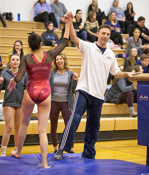 Prairie Ridge head coach Lee Battaglia high fives Maddy Kim after her vault routine during their gymnastics regional competition at Hersey High School on Monday, January 29, 2018 in Arlington Heights, Illinois. John Konstantaras photo for Shaw Media