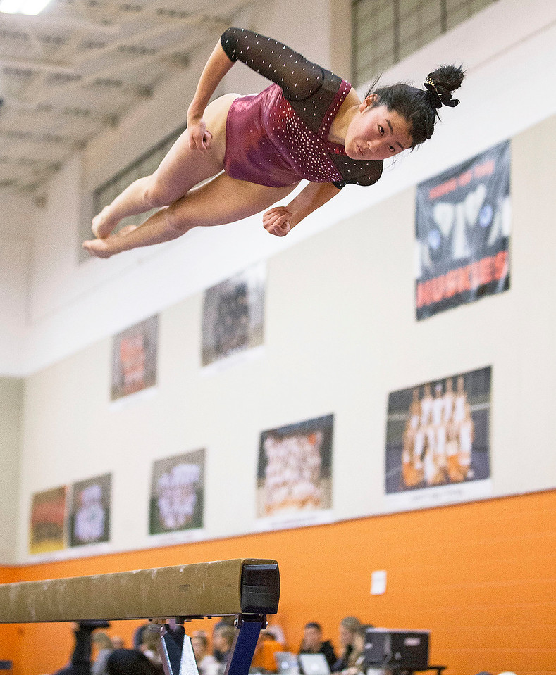 Prairie Ridge's Maddy Kim dismounts from the beam during their gymnastics regional competition at Hersey High School on Monday, January 29, 2018 in Arlington Heights, Illinois. John Konstantaras photo for Shaw Media