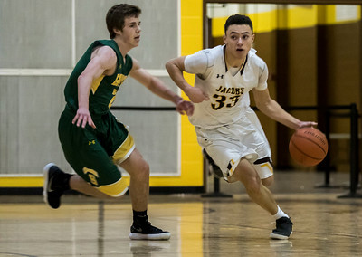 Sarah Nader - snader@shawmedia.com Crystal Lake South's Benjamin Geske (left) runs after  Jacobs' Nikolas Balkcom while he dribbles towards the basket during the third quarter at Jacobs' Hinkle Holiday Classic Wednesday, Dec. 27, 2017. Jacobs won, 54-40.