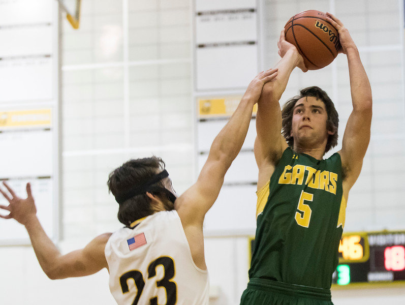 Sarah Nader - snader@shawmedia.com Jacobs' Daniel Murray (left) tries to block Crystal Lake South's Kyle Leva basket during the third quarter at Jacobs' Hinkle Holiday Classic Wednesday, Dec. 27, 2017. Jacobs won, 54-40.