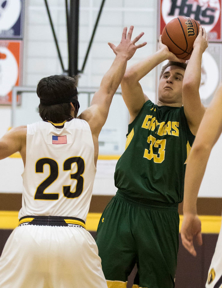 Sarah Nader - snader@shawmedia.com Crystal Lake South's Tyler Haskin shoots over Jacobs' Daniel Murray during the third quarter at Jacobs' Hinkle Holiday Classic Wednesday, Dec. 27, 2017. Jacobs won, 54-40.